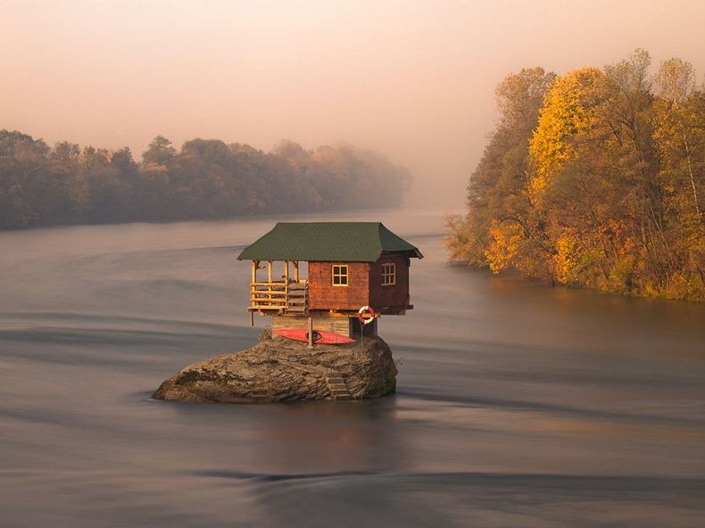 The beautiful serenity of a house surrounded by waters